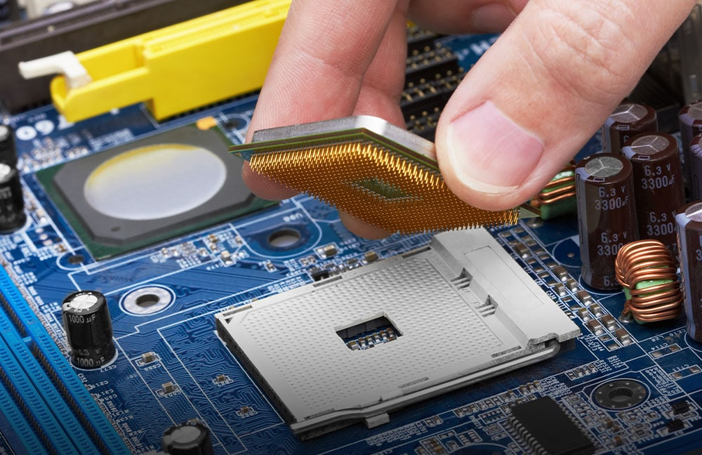 Image of person assembling a circuit board