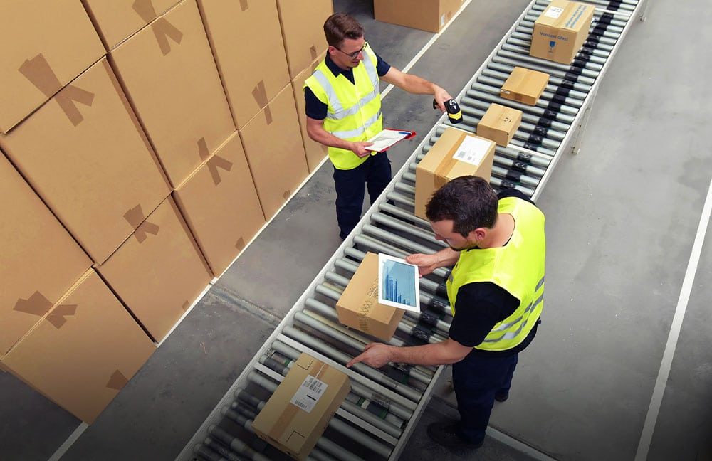 Image of workers packaging and shipping items. Links to the Packaging and Fulfillment service page
