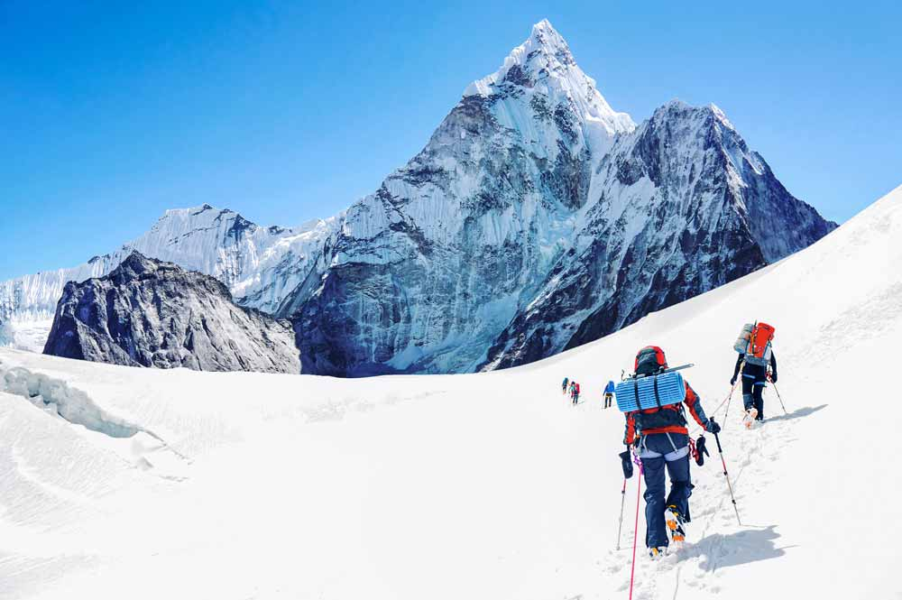 Image of Tom Whittaker climbing to the summit of Mt. Everest