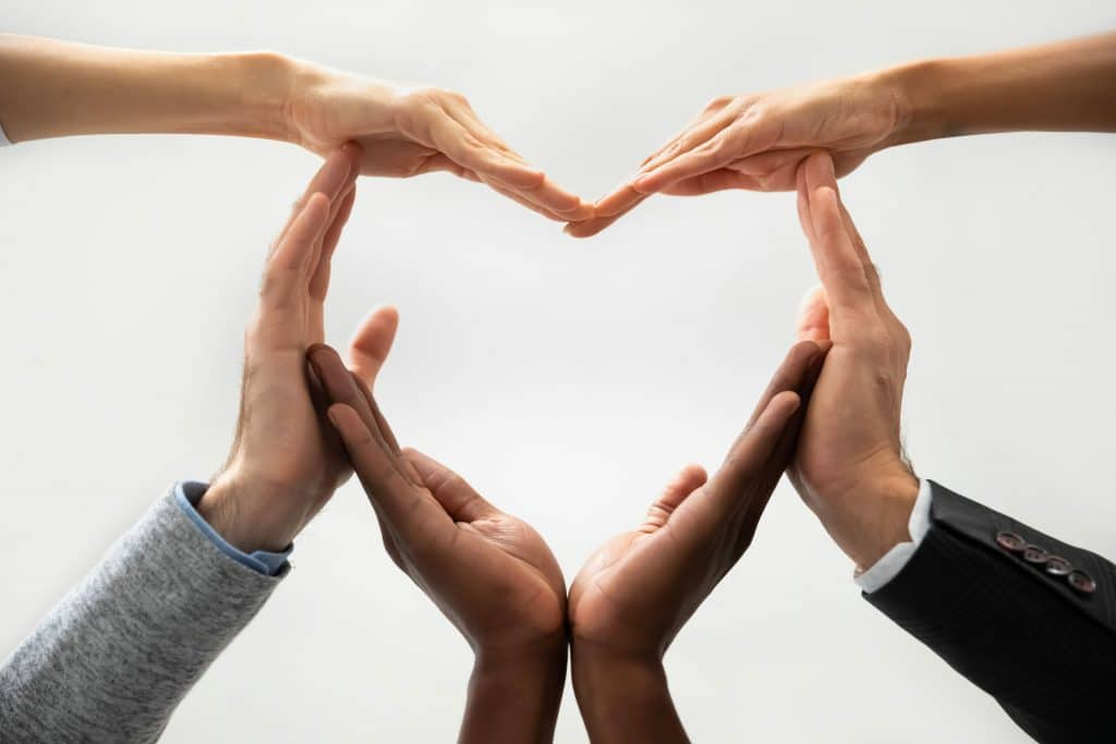 Image of people making a heart shape with their hands