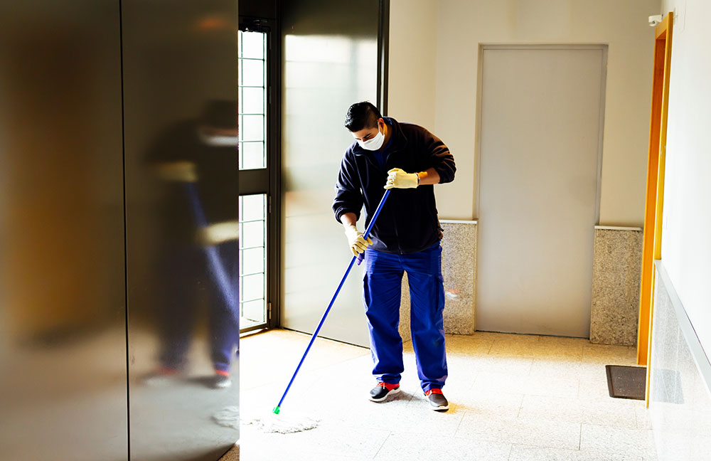 Image of custodian cleaning