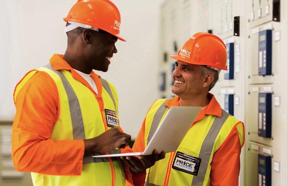 Image of two maintenance technicians talking