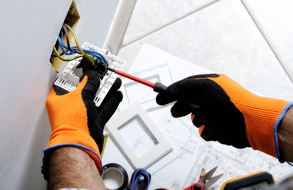 Image of electrician working at municipal facility